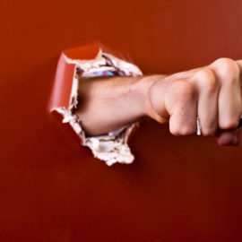 iStock_Hand-through-wall-Small