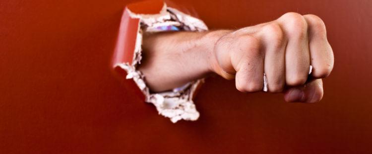 iStock_Hand-through-wall-Small